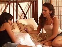 Lesbian girls Amber Chase and April ONeil explore their sapphic desires in the bedroom
